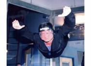 Picture of person in an indoor skydiving machine